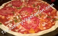 preparing a vegetable pizza